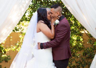 Kiss the Bride Moment at Garden Wedding Ceremony in Mesa Arizona
