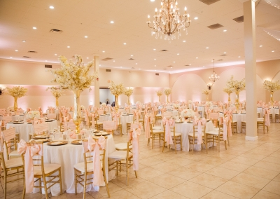pink and white decorated wedding reception hall