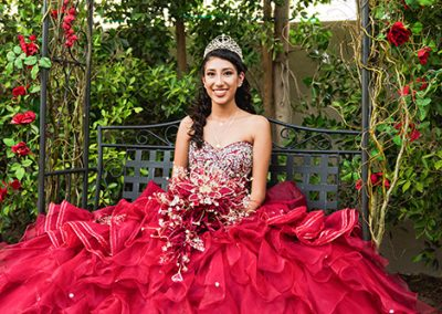 Quinceañera wearing beautiful red dress