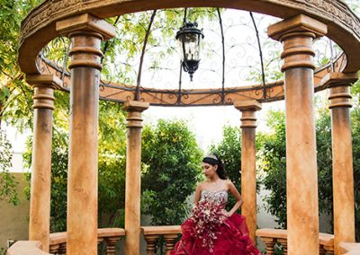 Quinceanera posing for photos in gazebo at Garden Tuscana