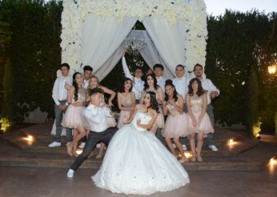 Quinceanera and guests taking fun outside photos