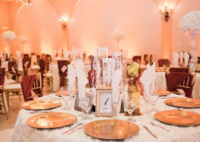 Garden Tuscana Reception Hall event in Mesa showing red and gold custom table decor in wedding reception