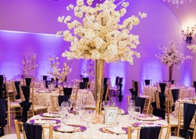 Garden Tuscana Reception Hall event in Mesa showing purple and gold custom table decor in wedding reception
