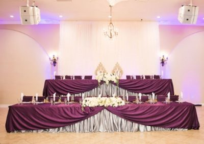Garden Tuscana Reception Hall event in Mesa showing head table in ballroom reception