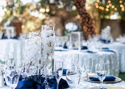 Garden Tuscana Reception Hall event in Mesa showing white and blue table settings for outdoor wedding reception