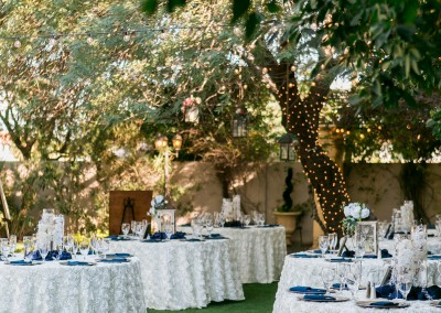 Garden Tuscana Reception Hall event in Mesa showing garden venue white wedding tables and chairs