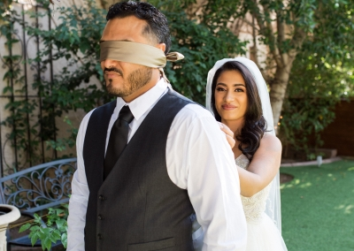 Garden Tuscana Reception Hall event in Mesa showing blindfolded groom with bride