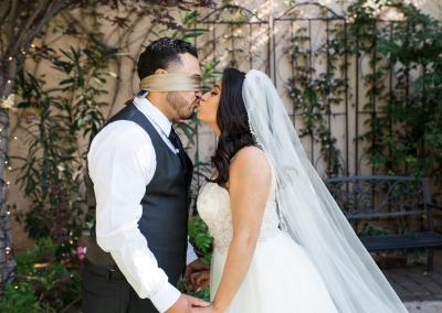 Garden Tuscana Reception Hall event in Mesa showing blindfolded kiss between bride and groom