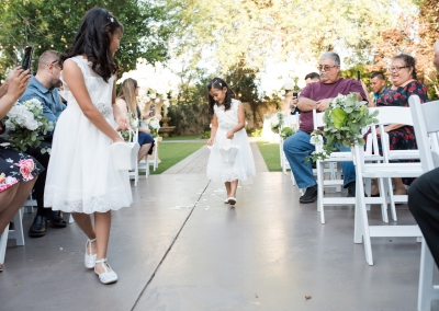 Garden Tuscana Reception Hall event in Mesa showing flower girls in outdoor ceremony