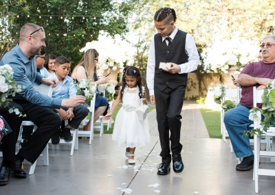 Garden Tuscana Reception Hall event in Mesa showing ring bearers in outdoor ceremony