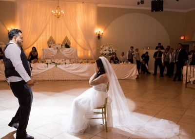 Garden Tuscana Reception Hall event in Mesa showing bride and groom removing garder