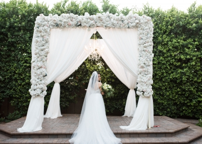 Garden Tuscana Reception Hall event in Mesa showing bride posing at draped altar