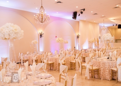 Garden Tuscana Reception Hall event in Mesa showing wedding reception decorated in champagne and ivory