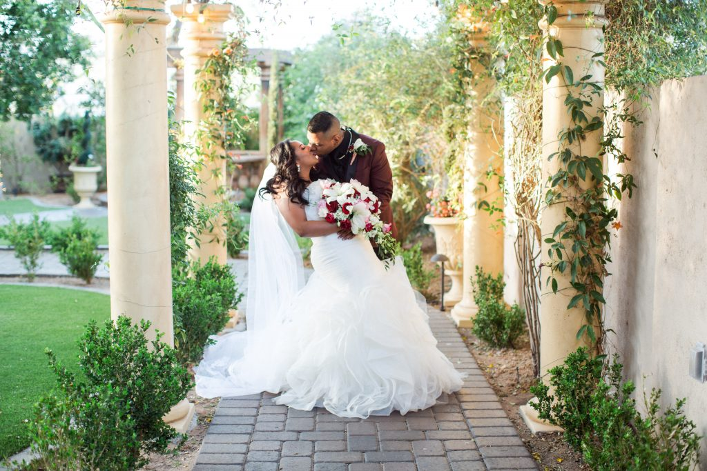 Garden Tuscana Reception Hall event in Mesa showing couple kissing outdoor wedding