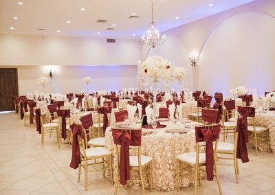 Garden Tuscana Reception Hall event in Mesa showing red and white custom table decor in ballroom