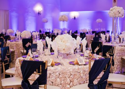Garden Tuscana Reception Hall event in Mesa showing beautiful white rose and deep blue wedding decor