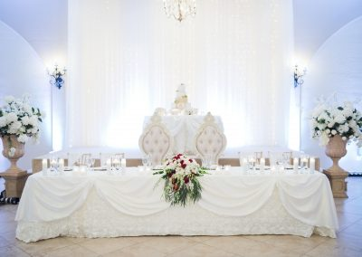 Garden Tuscana provides decorated head table as well as tables for gifts, cake, and signing book.