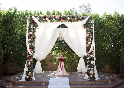 Rose decorated outdoor wedding altar