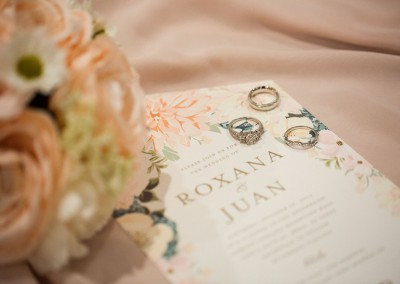 Garden Tuscana Reception Hall event in Mesa showing Roxana and Juan wedding invitations and ring