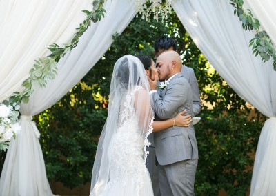 Garden Tuscana Reception Hall event in Mesa showing couple kissing at the altar