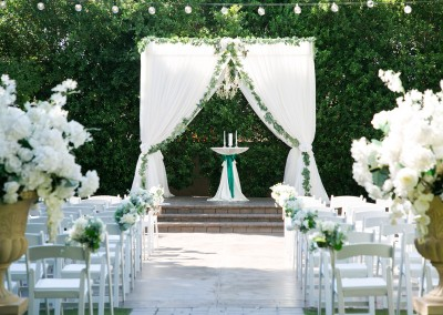 Garden Tuscana Reception Hall event in Mesa showing reception area with white altar