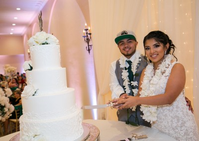 Garden Tuscana Reception Hall event in Mesa showing couple cutting cake at reception