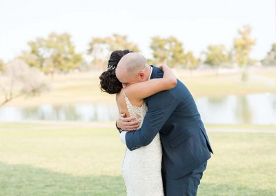 Garden Tuscana Reception Hall event in Mesa showing couple hugging on grass