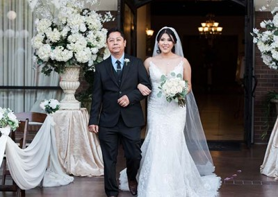 Garden Tuscana Reception Hall event in Mesa showing bride walking down aisle with father
