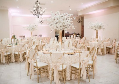Garden Tuscana Reception Hall event in Mesa showing reception area with white custom tables
