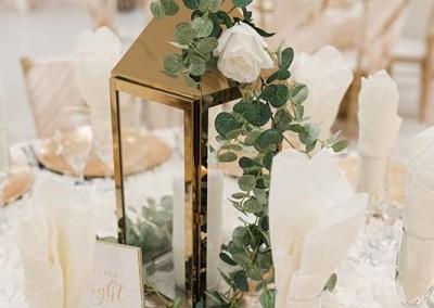 Garden Tuscana Reception Hall event in Mesa showing gold lantern centerpiece