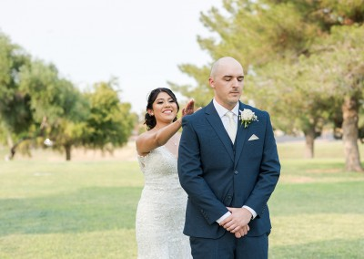Garden Tuscana Reception Hall event in Mesa showing bride surprising groom in garden area