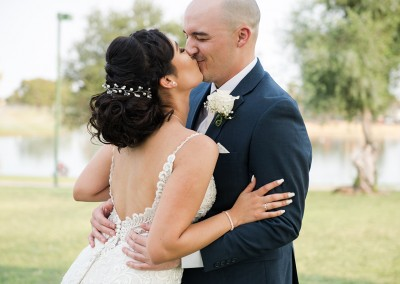 Garden Tuscana Reception Hall event in Mesa showing bride and groom kissing near lake
