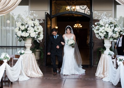 Garden Tuscana Reception Hall event in Mesa showing bride walking down aisle in outdoor ceremony