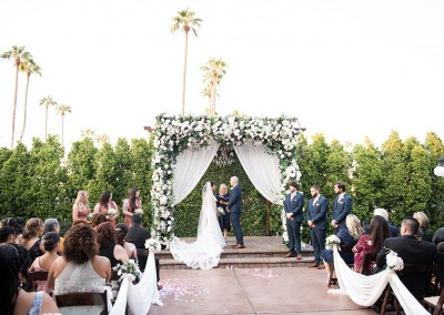 Garden Tuscana Reception Hall event in Mesa showing bride and groom at altar during ceremony