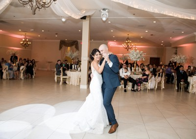 Garden Tuscana Reception Hall event in Mesa showing bride and grood dancing in reception hall