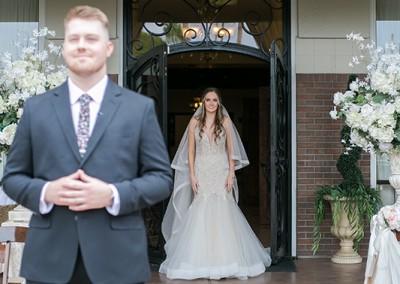 Garden Tuscana Reception Hall event in Mesa showing bride standing behind groom