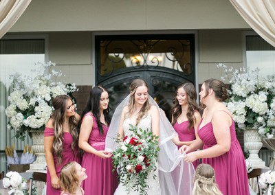 Garden Tuscana Reception Hall event in Mesa showing bridal party around bride