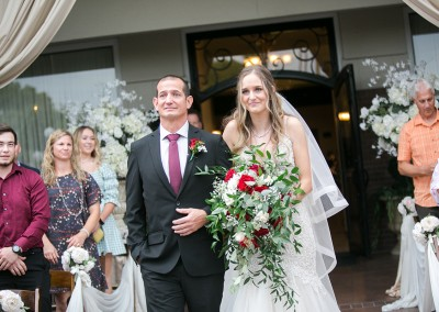 Garden Tuscana Reception Hall event in Mesa showing bride walking with father down the aisle