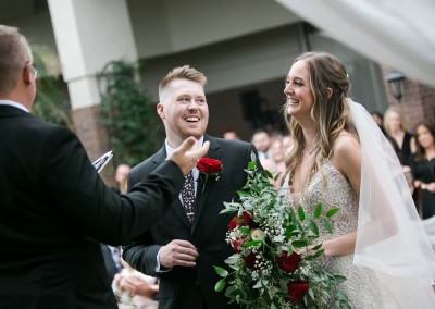 Garden Tuscana Reception Hall event in Mesa showing bride and groom laughing at ceremony
