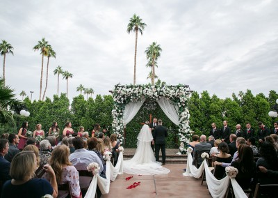 Garden Tuscana Reception Hall event in Mesa showing and groom at the altar outside