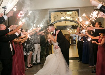 Garden Tuscana Reception Hall event in Mesa showing bride and groom kissing during departure